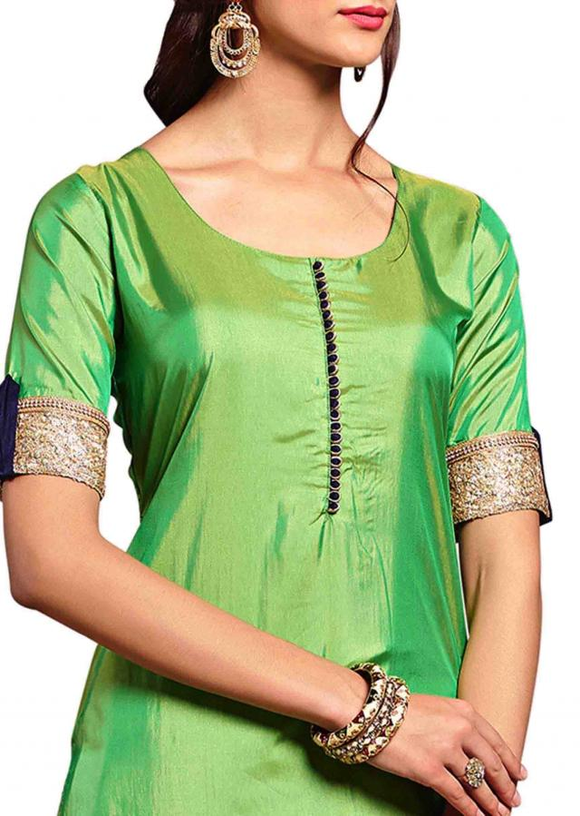 Green straight suit with sequin and moti embellished hem line