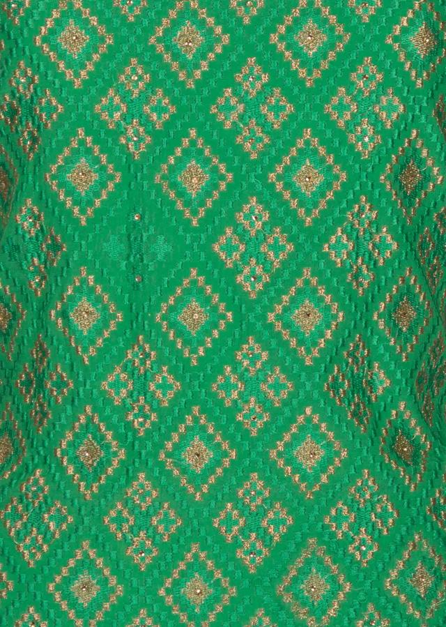 Green unstitched suit with golden embroidered lace only on Kalki