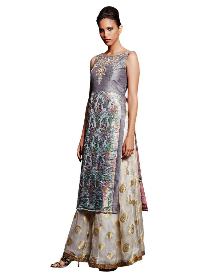 Grey brocade tunic with white and gold palazzo pant only on Kalki
