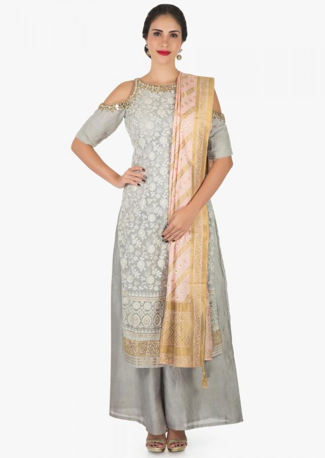 Grey cold shoulder palazzo suit adorn in thread and mirror embroidery work only on Kalki