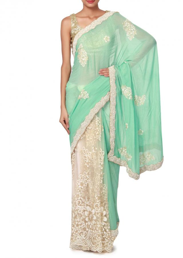 Half and half saree in blue and white enhanced in embroidered butti only on Kalki
