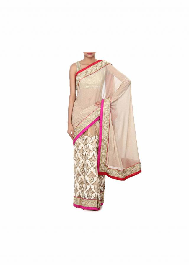 Half and half saree in gold and beige with thread and zari embroidery only on Kalki