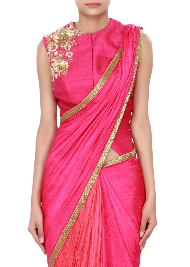 Rani pink saree features with gold border only on Kalki