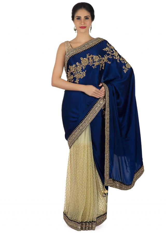 Half and half saree in royal blue and cream with embroidered border only on Kalki