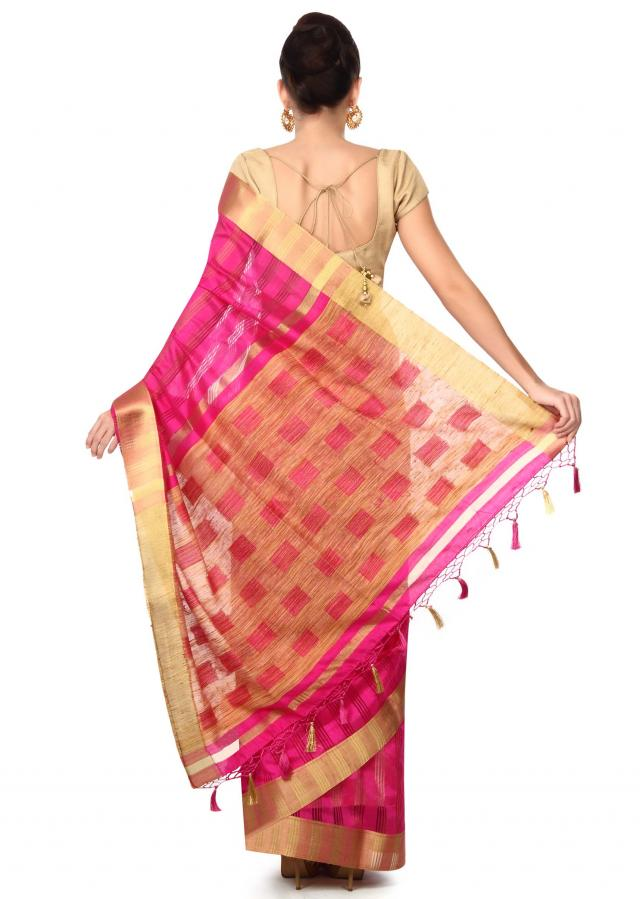 Hot pink saree in gold contrast border only on Kalki