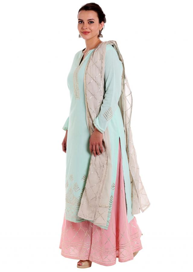Ice blue straight suit embellished in gotta patch lace only on Kalki