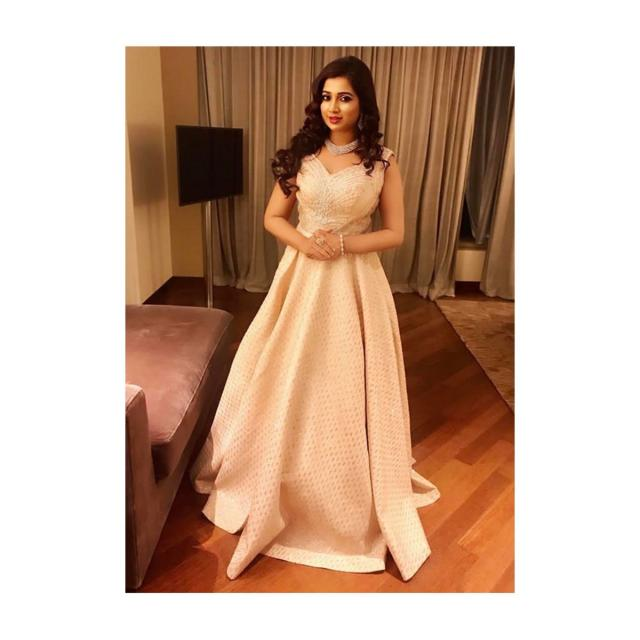 Shreya Goshal in kalki cream fancy shimmer gown in sequins butti with deep v from back