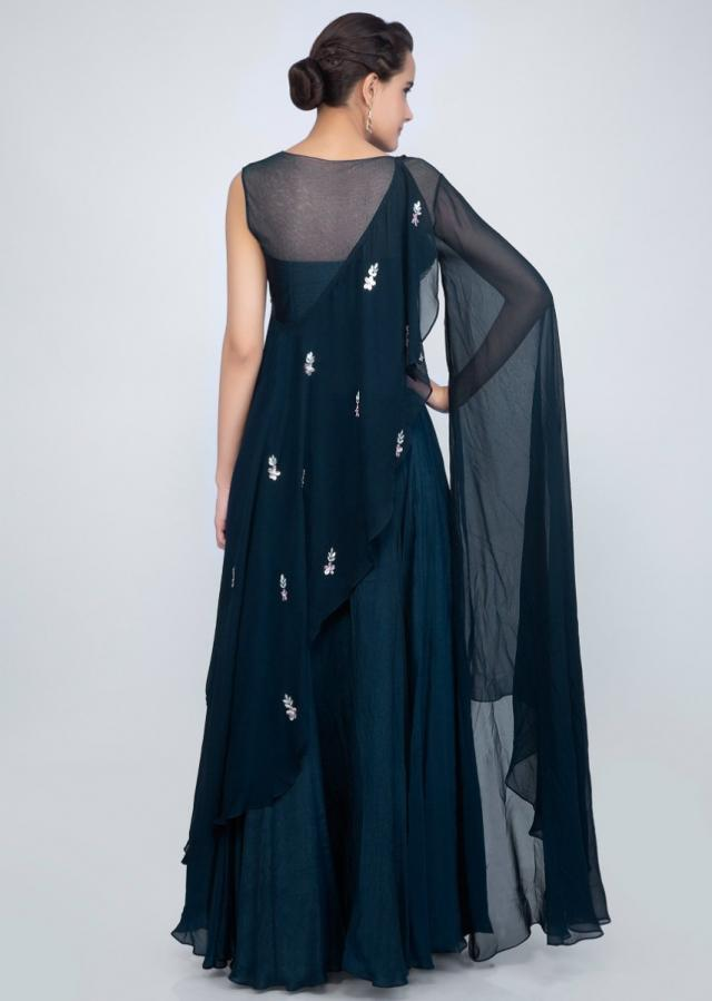 Indigo blue crepe lehenga with one side flared sleeves and a wrap around embroidered cape only on Kalki