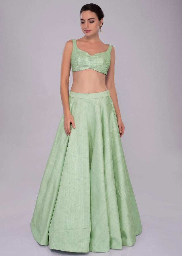 Irish green raw silk skirt and blouses paired with long net embroidered jacket only on Kalki