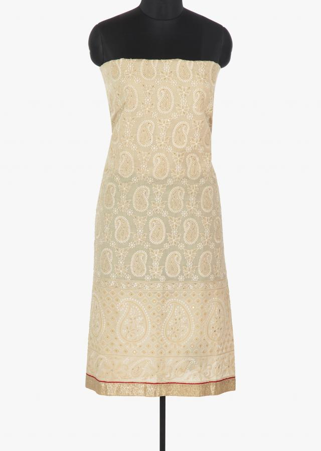Ivory  cotton unstitched suit embossed with thread work in paisley motif only on Kalki