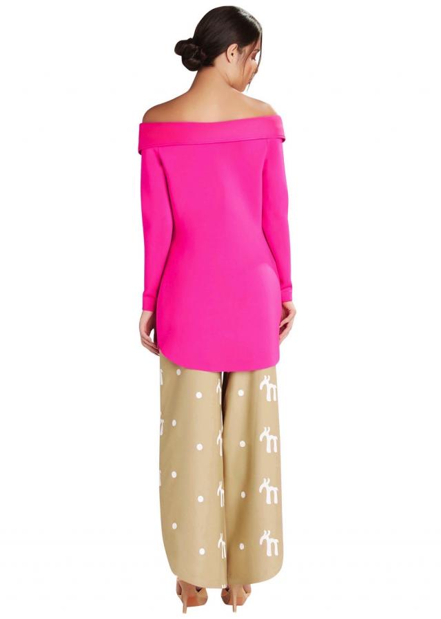 Khaki script curved pants and Pink neoprene off shoulder top by Masaba