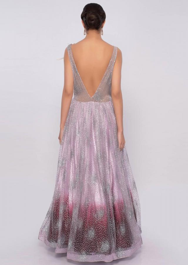 Lavender and maroon shaded shimmer net gown only on Kalki