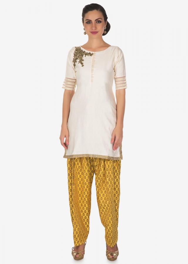 Cream and yellow salwar suit embellished in zardosi and cut dana butti only on Kalki