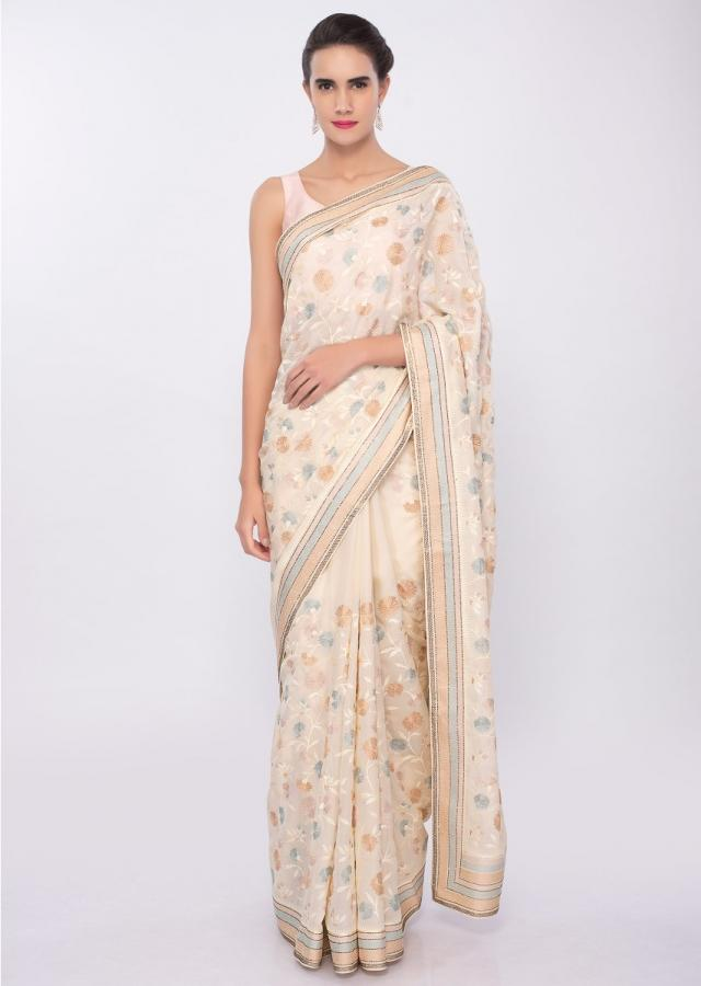 Light Cream satin silk saree in multi color floral thread embroidered jaal work only on Kalki