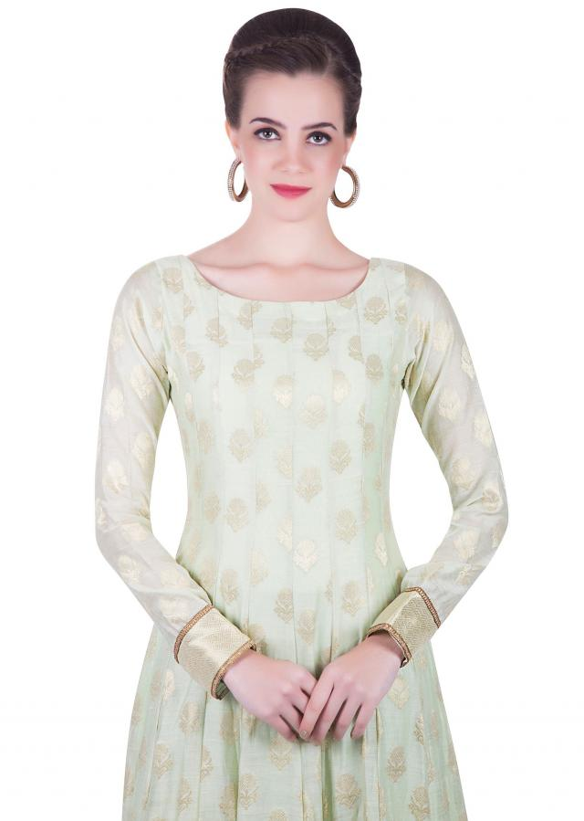 Light Green Churidar Kameez Ensemble Styled with Lurex and Lace Border only on Kalki