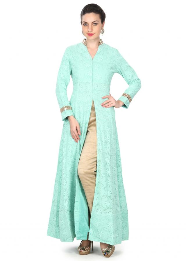 Light green suit in thread and mirror work only on Kalki
