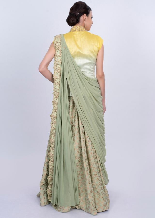 Light green weaved skirt with embroidered blouse and prestitched lycra dupatta only on Kalki