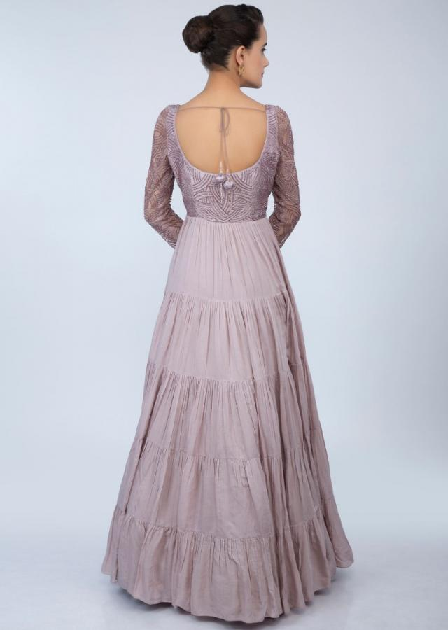 Light lilac gown with embroidered net bodice and gathers all over only on Kalki