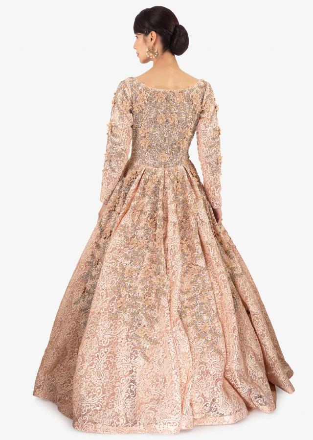 Light peach ballroom lace gown embellished in embroidery and 3 D flowers only on Kalki