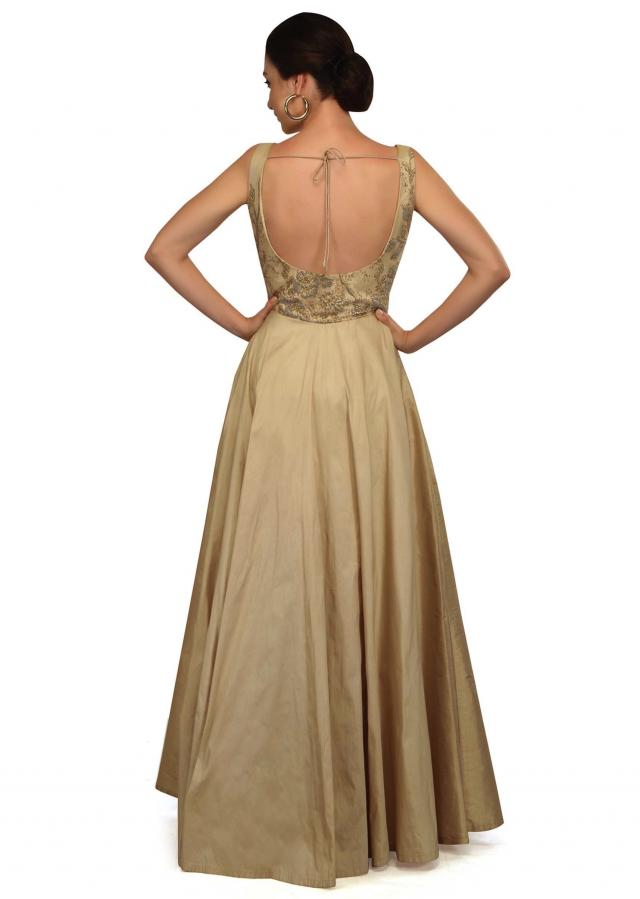 Beige gown features with embellished net only on Kalki