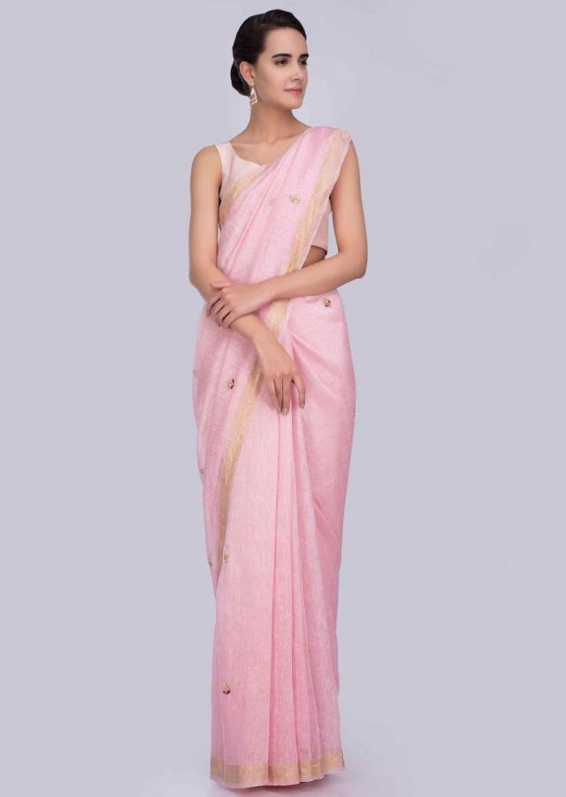 Light pink linen saree adorn with embroidered butti and border only on Kalki