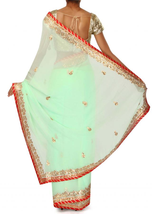 Light pista green saree adorn in gotta patch embroidery only on Kalki