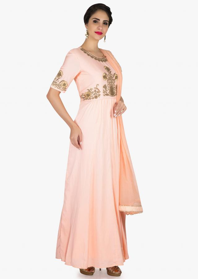 Light peach anarkali suit in cotton silk with floral embroidered butti at bodice only on Kalki
