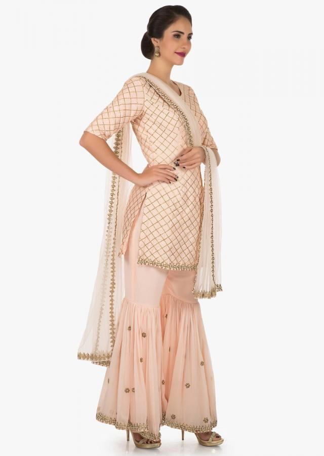 Light Peach Sharara Suit Beautified In Zari Embroidered Work Online - Kalki Fashion