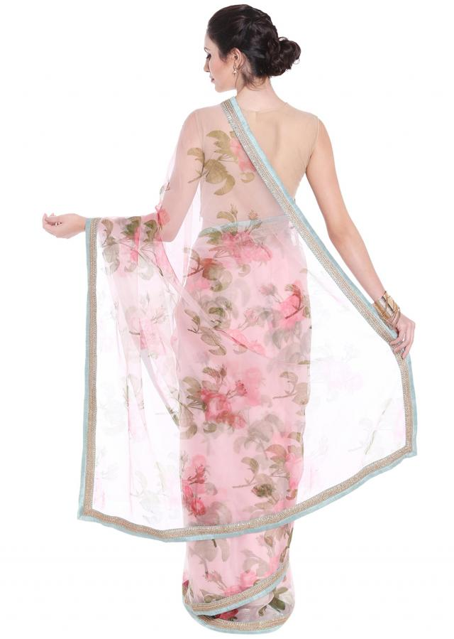 Lilac pink saree embellished in floral motif with contrast border only on Kalki