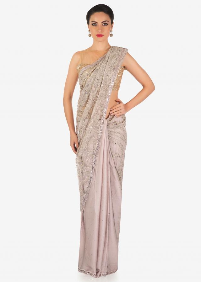 Lilac pink half and half saree in zari and sequin embroidered net only on Kalki