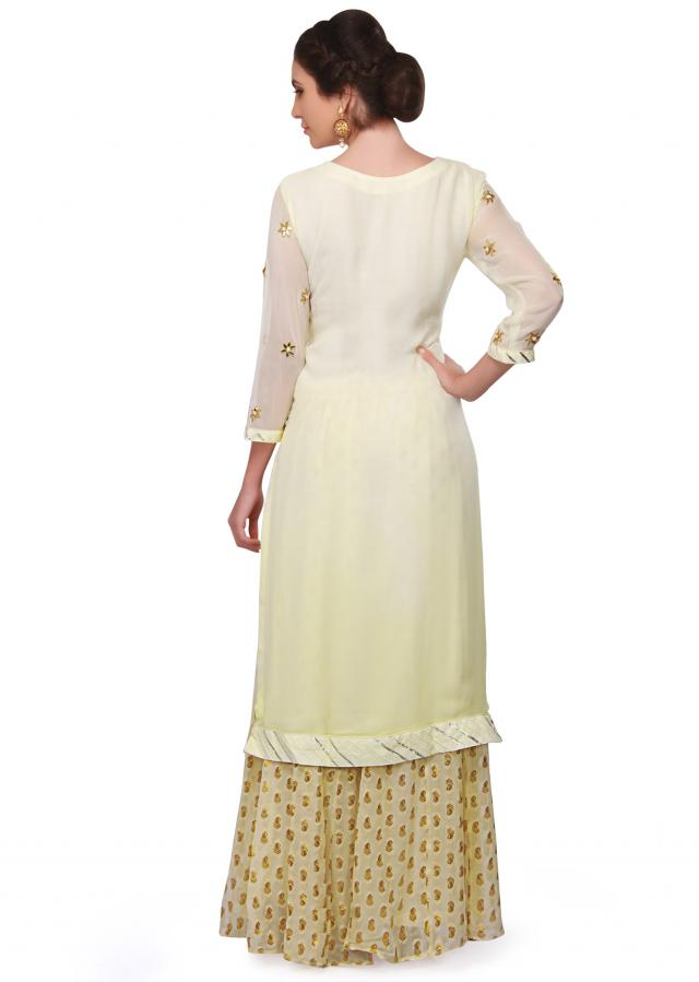 Lime yellow anarkali suit embellished in resham and gotta lace only on Kalki
