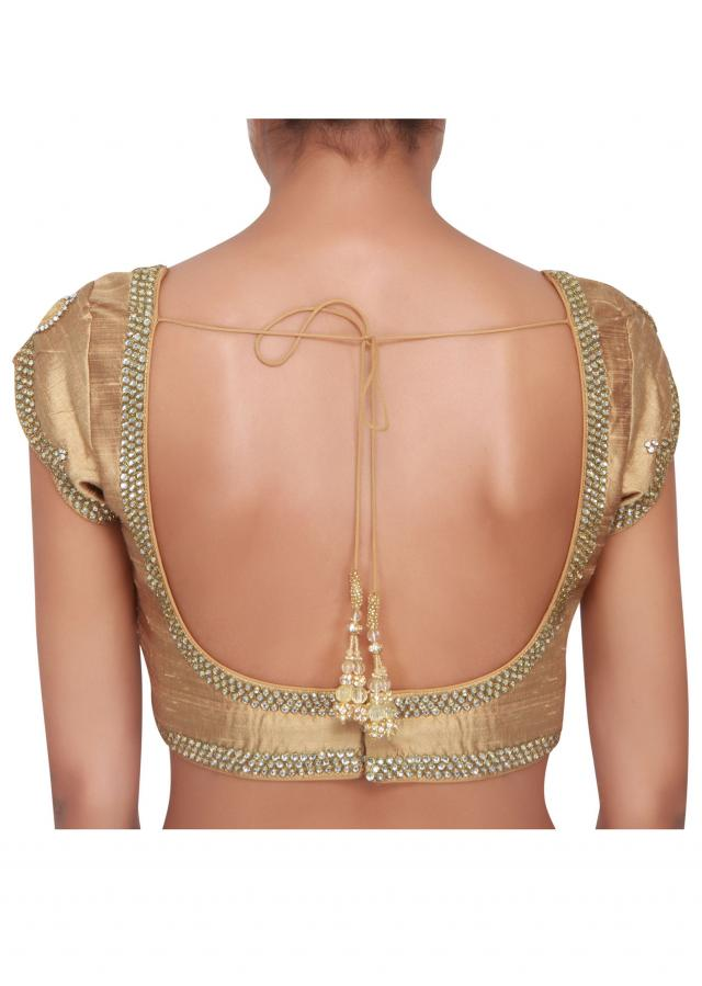 Liquid gold blouse featured in raw silk, embellished in stone  only on Kalki