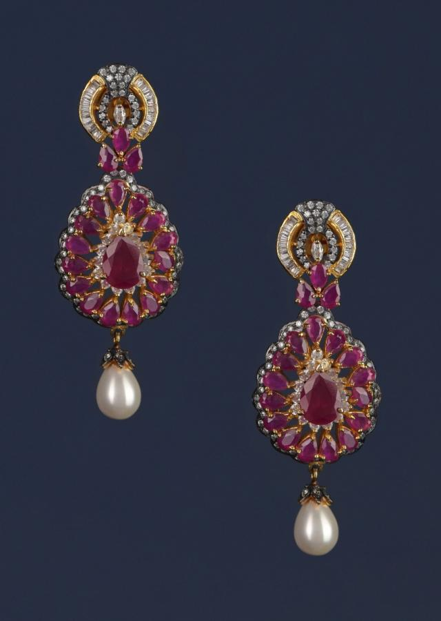 Magenta Crystal Studded Drop Shaped Danglers With Stones And Dangling Pearl Online - Kalki Fashion