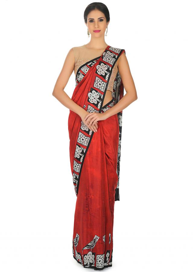 Maroon saree in crepe satin with human face motif only on Kalki