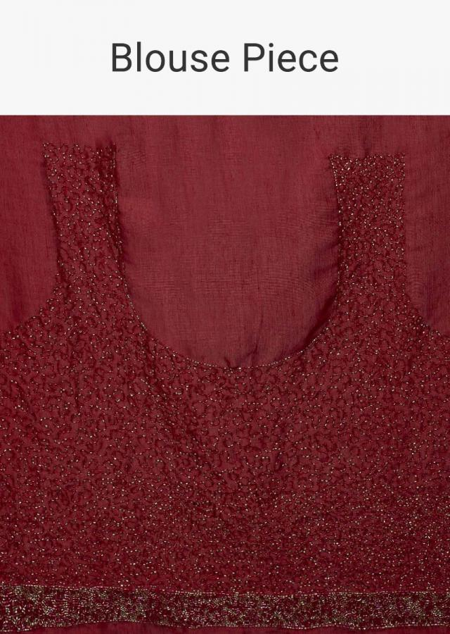 Maroon satin crepe saree with cut dana embroidered border only on Kalki