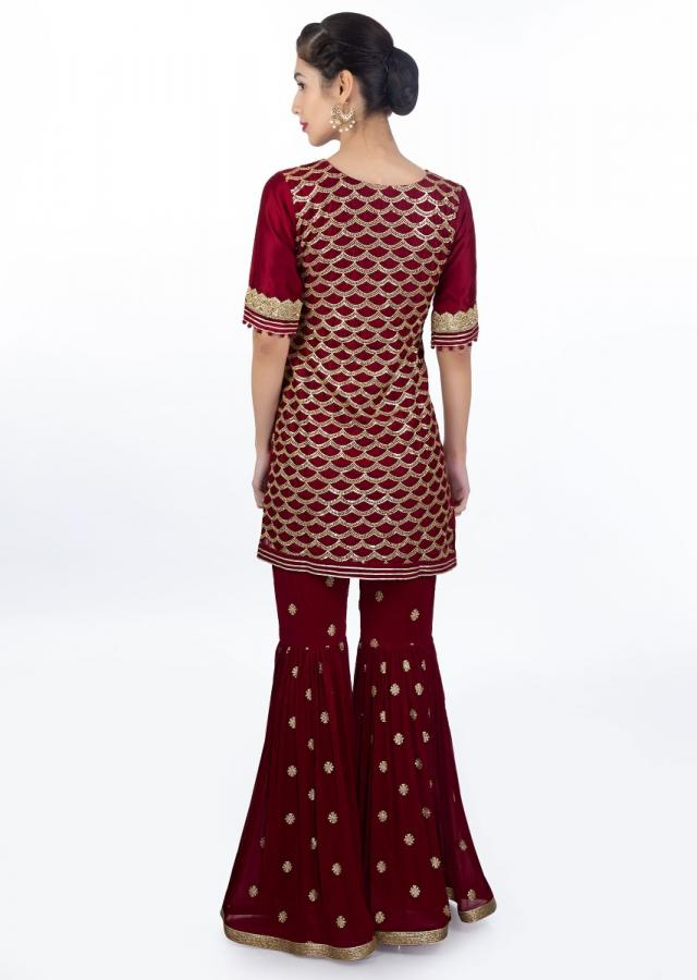 Maroon Suit In Fish Tail Motif Paired With A Matching Georgette Sharara And Net Dupatta Online - Kalki Fashion