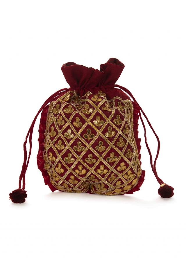Maroon potli bag beautified in gotta patti embroidered work only on Kalki