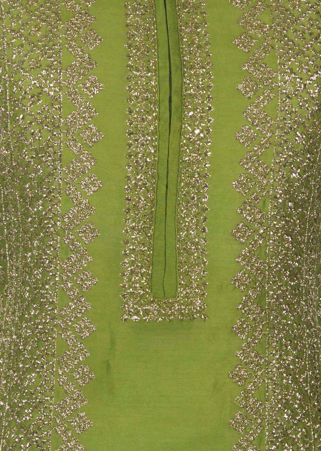 Mehendi green semi stitched suit with zari embroidery in center panel only on Kalki