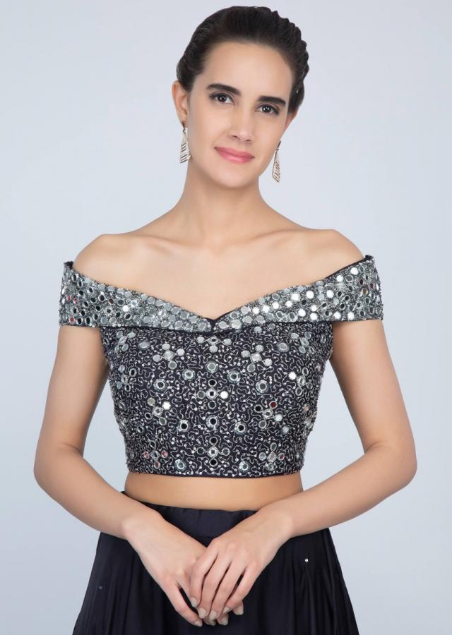 Mid night blue lehenga with embroidered off shoulder blouse and net dupatta  only on kalki