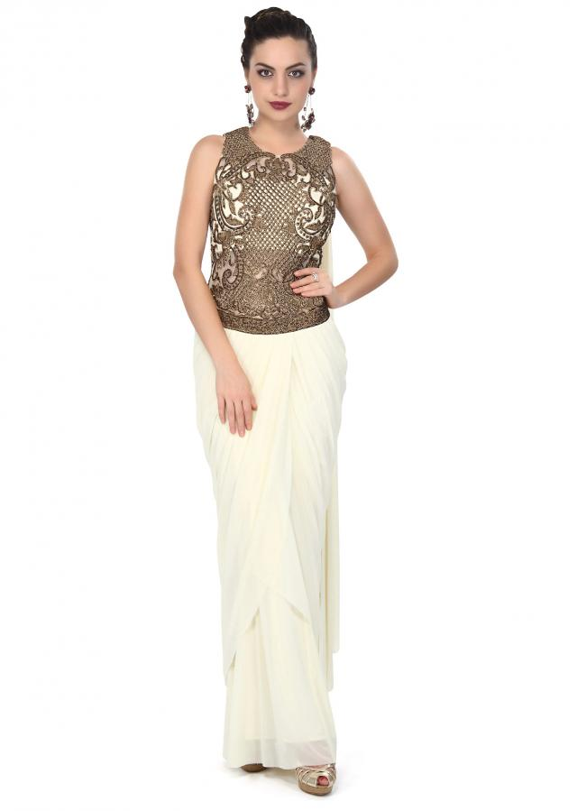Cream saree gown enhanced in zari and kundan embroidery only on Kalki