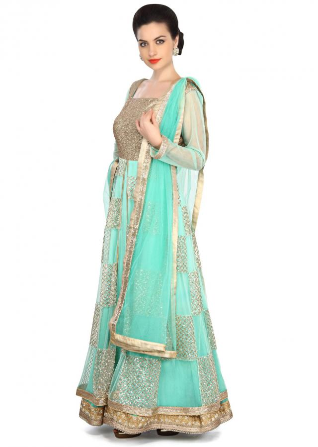 Mint green anarkali suit embellished in shimmer only on Kalki