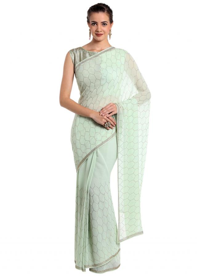 Mint green chiffon saree embellished with kundan work only on Kalki