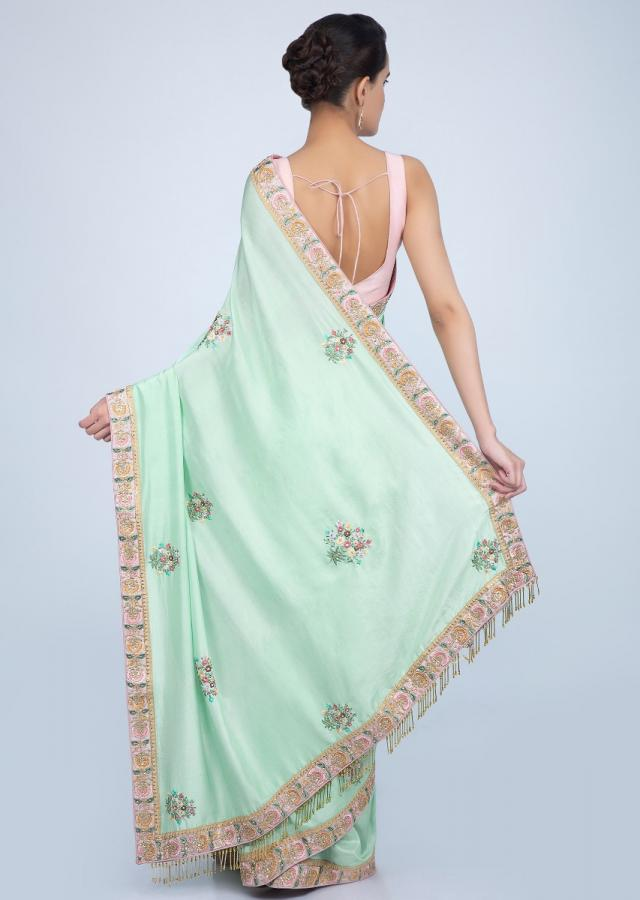 Mint green dupion silk saree with floral embroidered butti and border only on Kalki