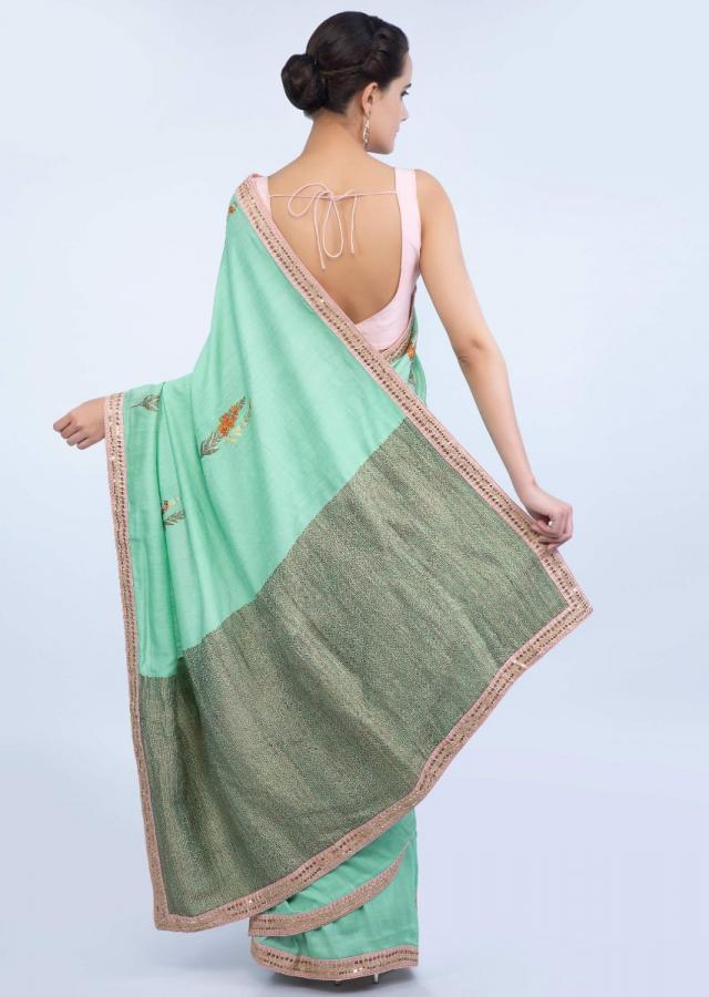Mint green dupion silk saree with weaved butti and pallo only on Kalki