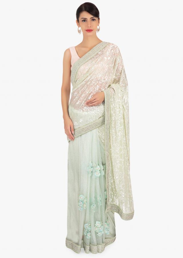 Mint green half and half saree in net and jacquard lycra only on Kalki