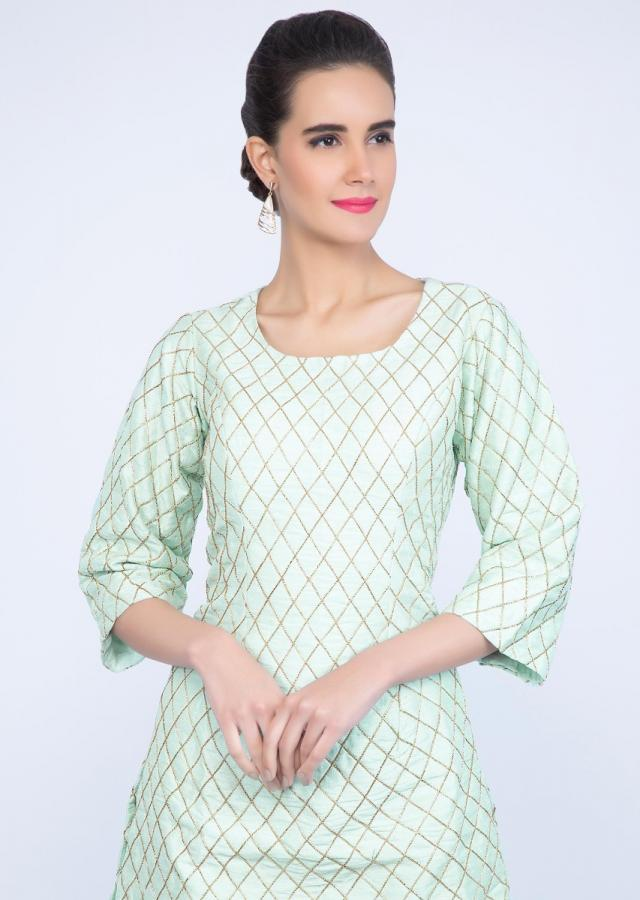 Mint green sharara suit set in checks jaal embroidery only on kalki