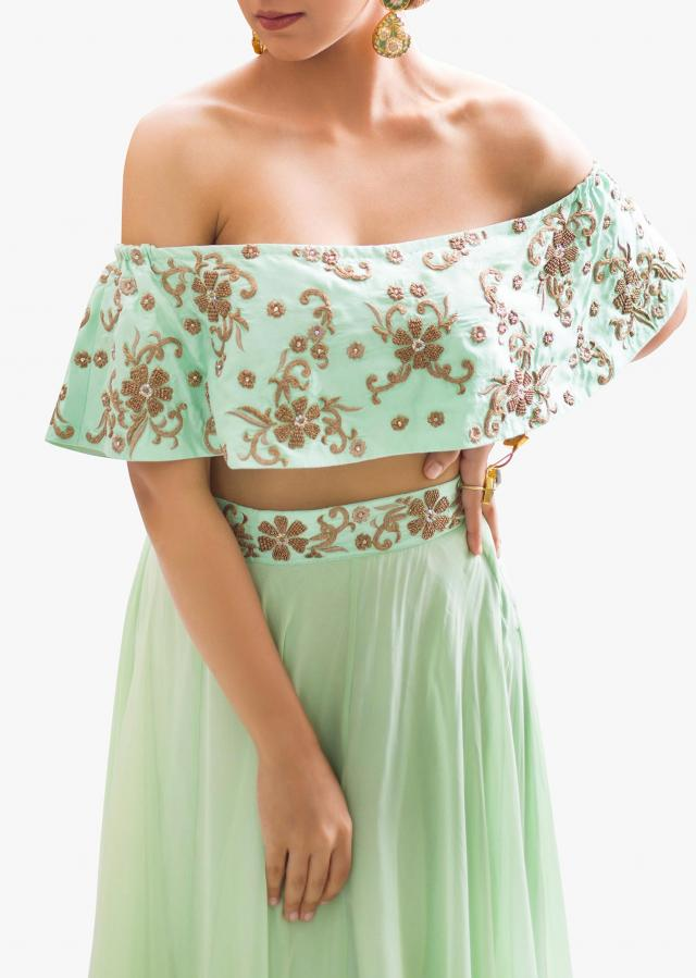 Mint green lehenga matched with off shoulder embroidered cape