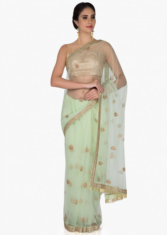 Mint Green Net Saree and Raw Silk Blouse Adorned with Zari and Sequins only on Kalki