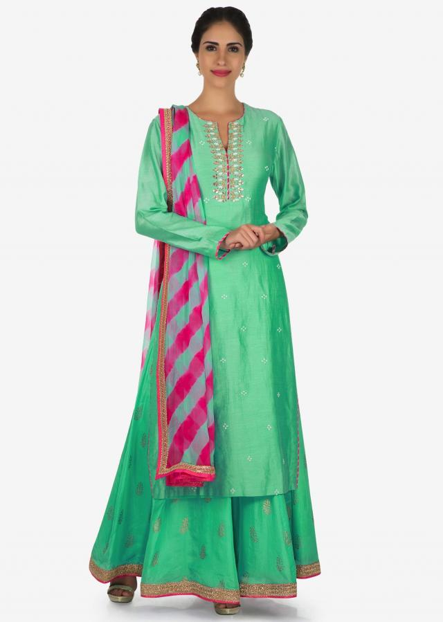 Mint green palazzo suit in silk adorn with gota patti embroidery work only on Kalki