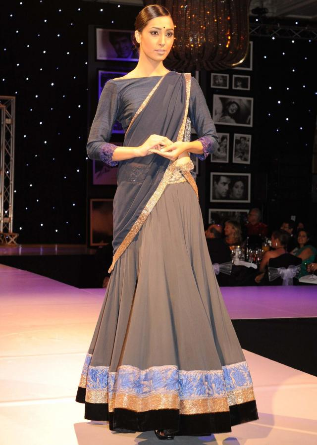 Models showcasing Manish Malhotra festive collection celebrating 100 years of indian cinema in London 01